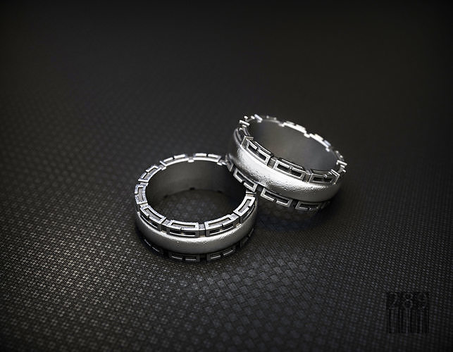 silver ring with patterns on the sides