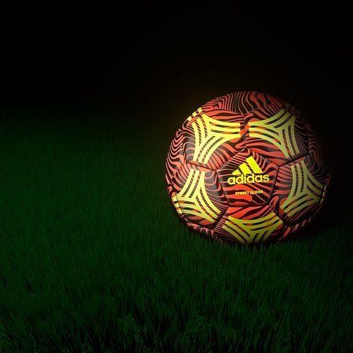 Adidas Ball with grass