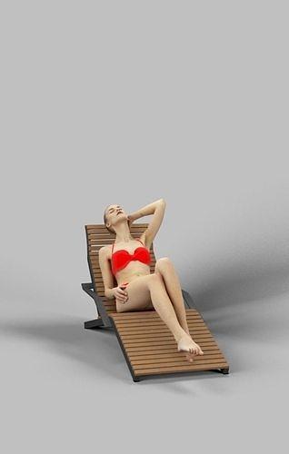 Beauty A Caucasian Female Lying On A Lounger In Her Red Bikini