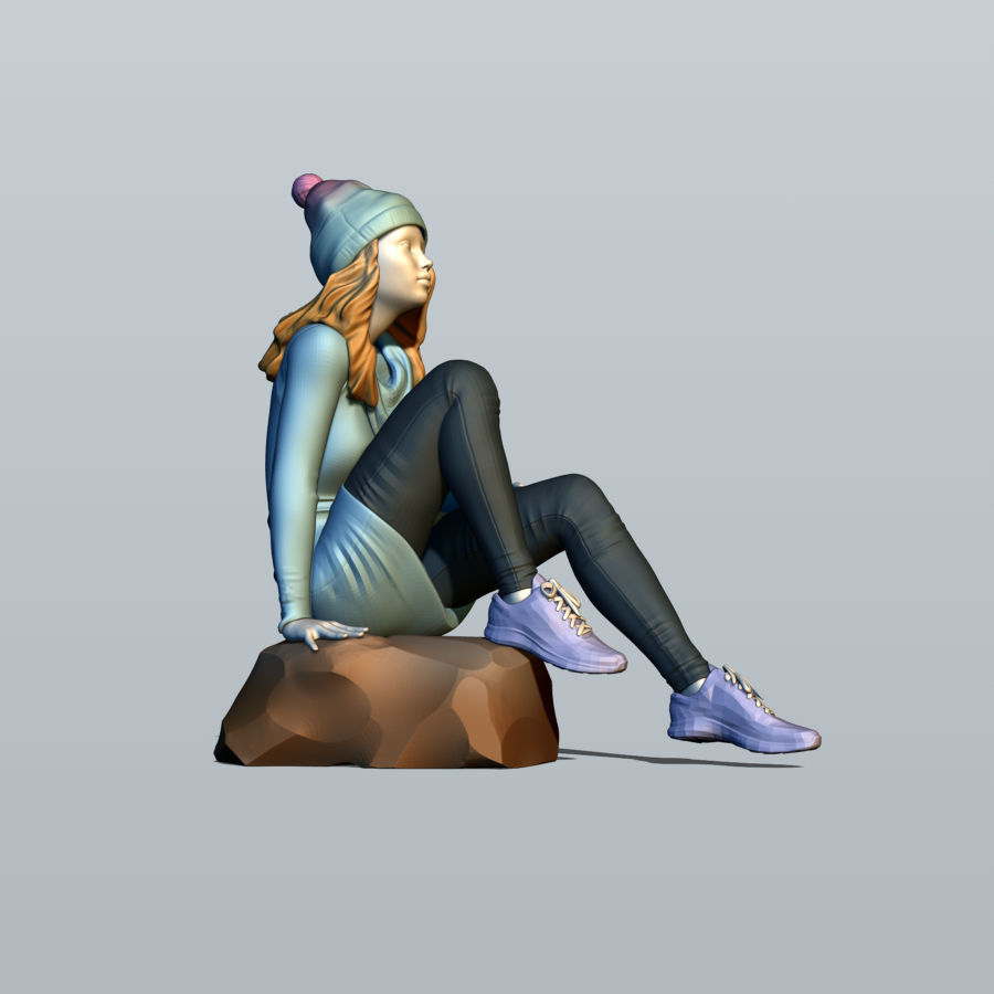 Girl sitting on a stone