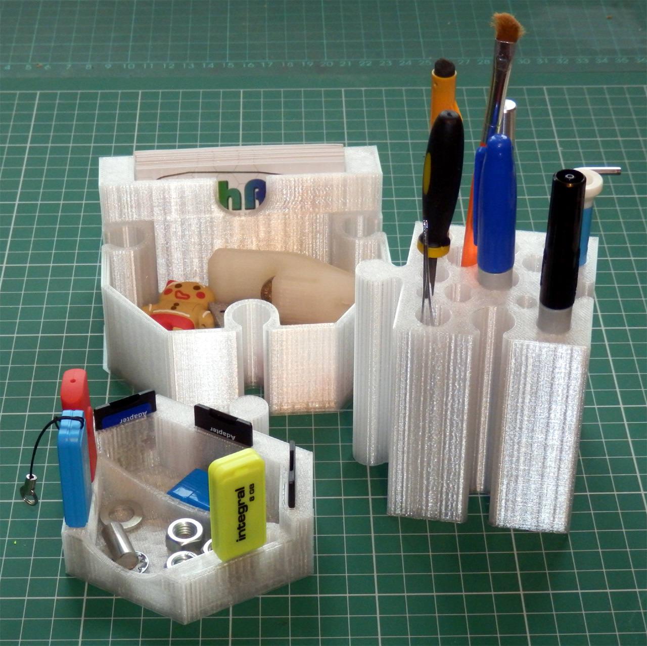 A Set Of Six Jigsaw Desk Tidy Pots