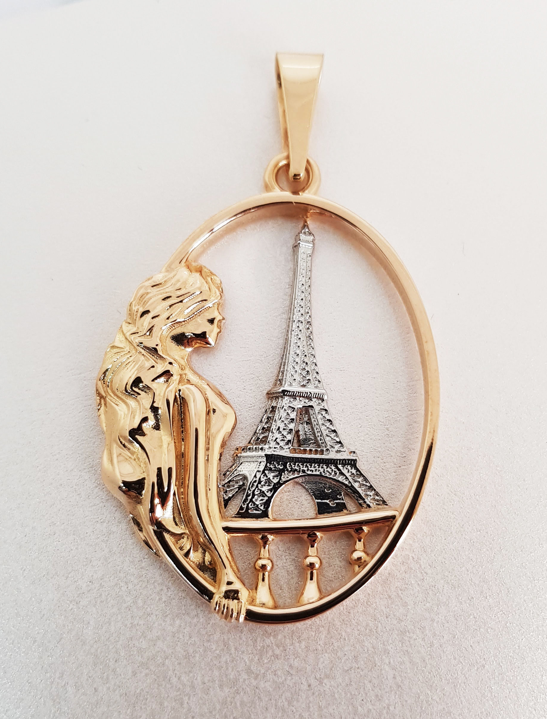 The Gold Pendant Girl on the balcony and Eiffel Tower